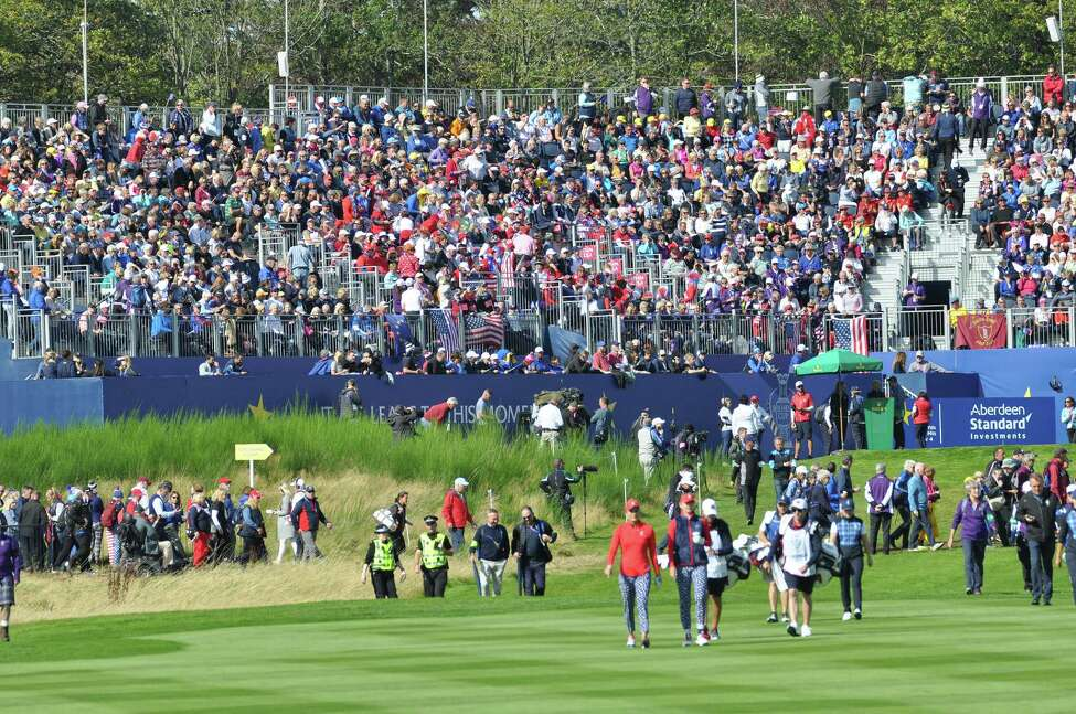 With music blaring and crowds cheering for Team Europe and Team USA, the grandstand on the first tee of the Solheim Cup is like no other in the sport of women's golf. Team USA players Lexi Thompson and Jessica Korda walk up the first fairway in a Friday Fourball match on Sept. 13, 2019, against Team Europe's Carlotta Ciganda and Bronte Law. (Joyce Bassett / Times Union)