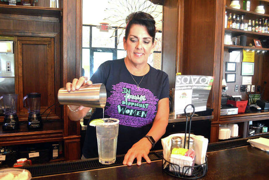 Owner Lisa Ybarra prepares a margarita at Chava's Mexican Restaurant in Edwardsville. Chava's is among 14 local restaurants participating in the SAVOR 2019 restaurant week campaign. Photo: Scott Marion/The Intelligencer