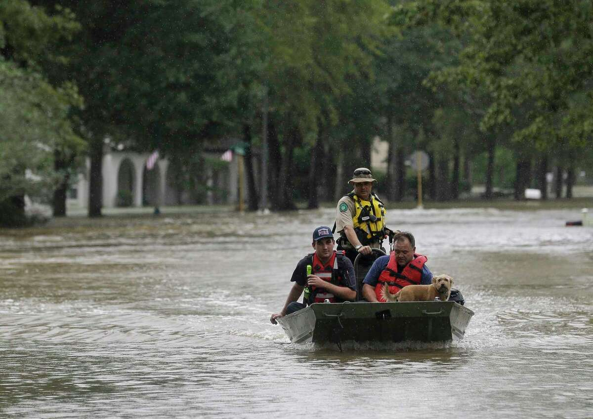 First responders with the Harris County Sheriff's Office, Texas Game Warden, and Huffman Fire Department rescued people from flooded homes in the Lochshire neighborhood Friday, Sept. 20, 2019, in Huffman, Texas. The Luce Bayou overflowed due to the heavy rain during Tropical Storm Imelda. (Godofredo A. Vasquez/Houston Chronicle via AP)