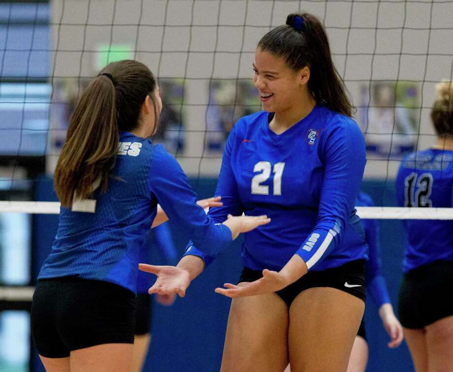 Fallon Thompson #21 of Grand Oaks reacts with Sam Noriega after scoring a point during the first set of a District 20-5A high school volleyball match at Grand Oaks High School, Tuesday, Sept. 24, 2019, in Spring. Photo: Jason Fochtman, Houston Chronicle / Staff Photographer / Houston Chronicle
