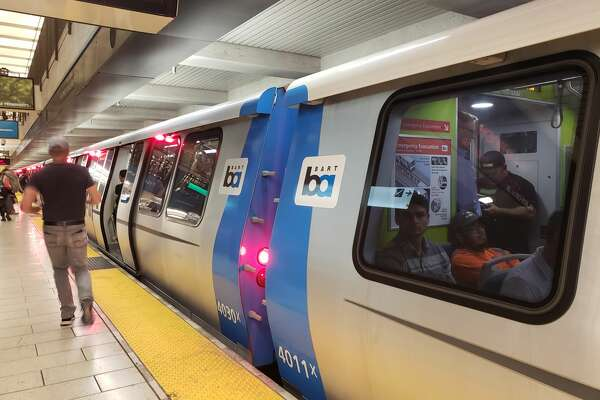 Commuters ride in one of the BART Fleet of the Future cars on Sept. 24, 2019.