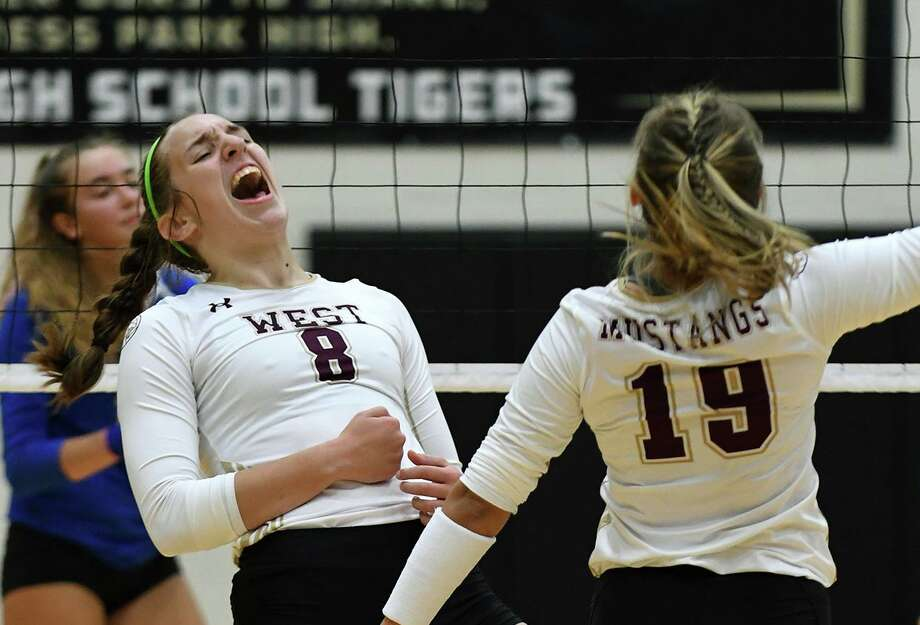 FILE PHOTO — Magnolia West junior setter Alyssa May (8) celebrates a point against Klein with junior teammate Kaitlyn Breland (19) during their pool play matchup in the 2019 Katy/Cy-Fair Volleyball Classic at Cy Parks High School on August 8, 2019. Photo: Jerry Baker, Houston Chronicle / Contributor / Houston Chronicle