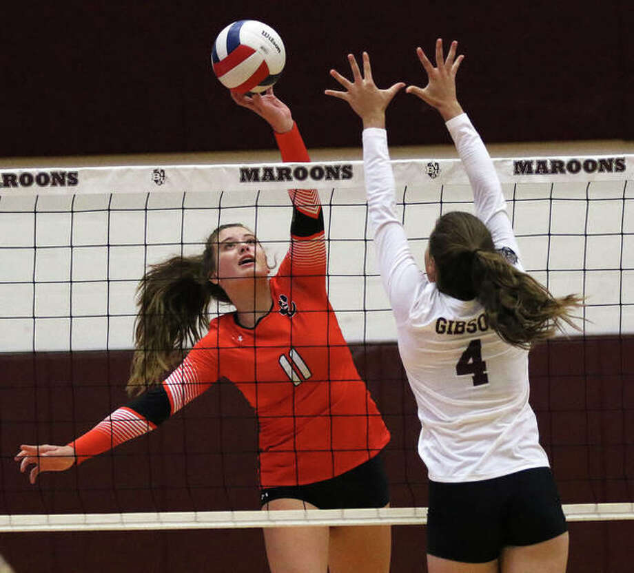 Edwardsville sophomore Gabby Saye (left) gets a kill over the block of Belleville West's Elise Gibson in a SWC girls volleyball match on Tuesday night at Belleville. Photo: Greg Shashack / The Telegraph