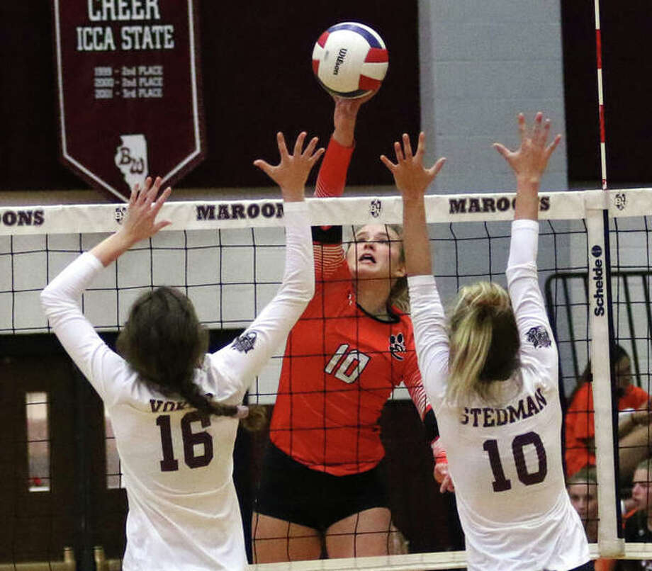 Edwardsville sophomore Emma Garner (middle) hits for one of her five kills in the third set before Belleville West's Sydney Vokes (16) and KC Stedman (10) can rise up for a block on Tuesday night at Belleville. Photo: Greg Shashack / The Intelligencer