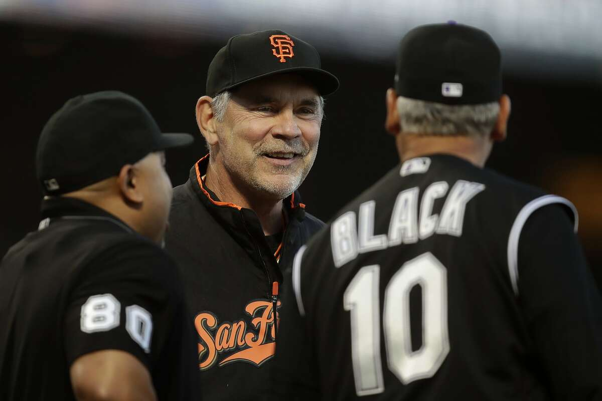 San Francisco Giants manager Bruce Bochy, center, smiles while speaking to Colorado Rockies manager Bud Black (10) prior to a baseball game Tuesday, Sept. 24, 2019, in San Francisco. (AP Photo/Ben Margot)