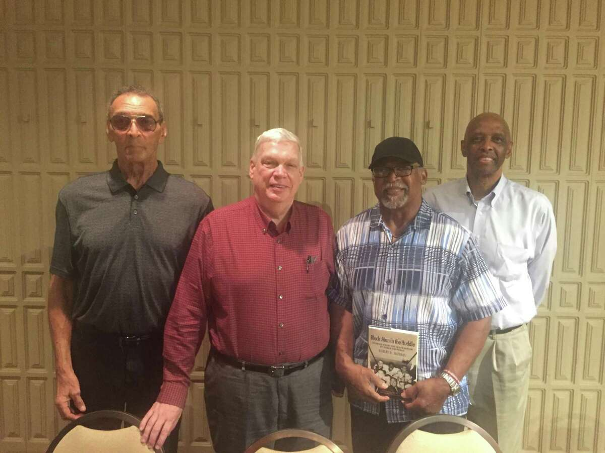 Tony Guillory,Robert Jacobus, Joe Brown andMichael Hurd pose for a picture in the Plummer Room of Lamar University's library after participating in a discussion about the history African American football players in Texas. Photo by Matt Faye/The Enterprise.