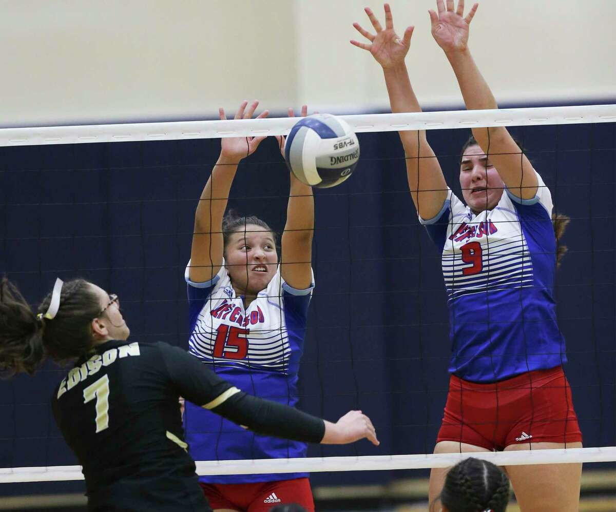 Mustang defenders Sahyani Cortez, 15, and Summer Silva block a shot at the net by Cassandra De Los Santos as Jefferson plays Edison in volleyball at the Alamo Convocation Center on Sept. 24, 2019.