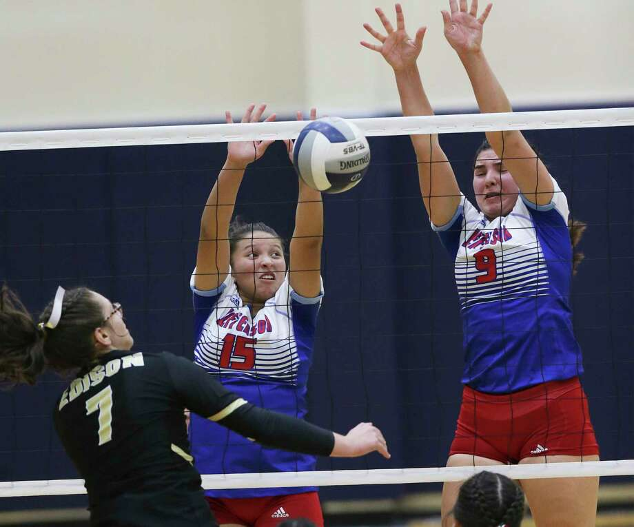 Mustang defenders Sahyani Cortez, 15, and Summer Silva block a shot at the net by Cassandra De Los Santos as Jefferson plays Edison in volleyball at the Alamo Convocation Center on Sept. 24, 2019. Photo: Tom Reel, Staff / Staff Photographer / 2019 SAN ANTONIO EXPRESS-NEWS