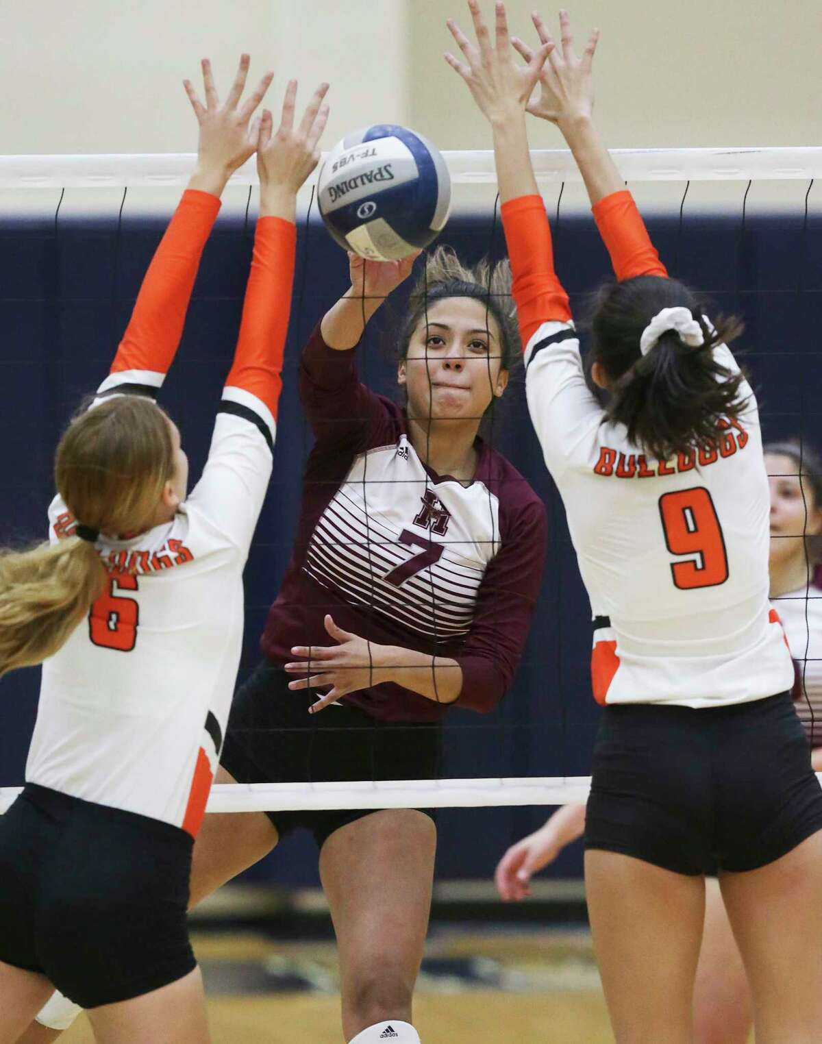 The Owls' Briana Contreras fires a shot through the defense as Burbank beats Highlands 3-1 in volleyball at the alamo Convocation Center on Sept. 24, 2019.
