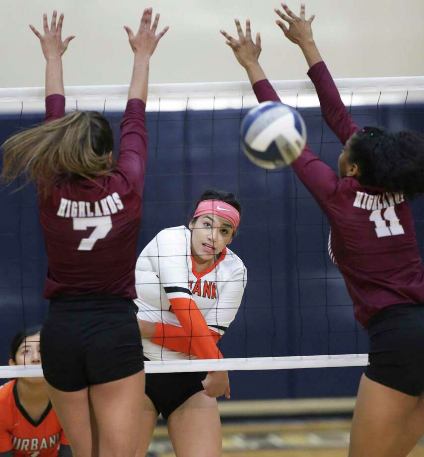 Shanelle Martinez threads a shot through Owl defenders as Burbank beats Highlands 3-1 in volleyball at the alamo Convocation Center on Sept. 24, 2019. Photo: Tom Reel, Staff / Staff Photographer / 2019 SAN ANTONIO EXPRESS-NEWS