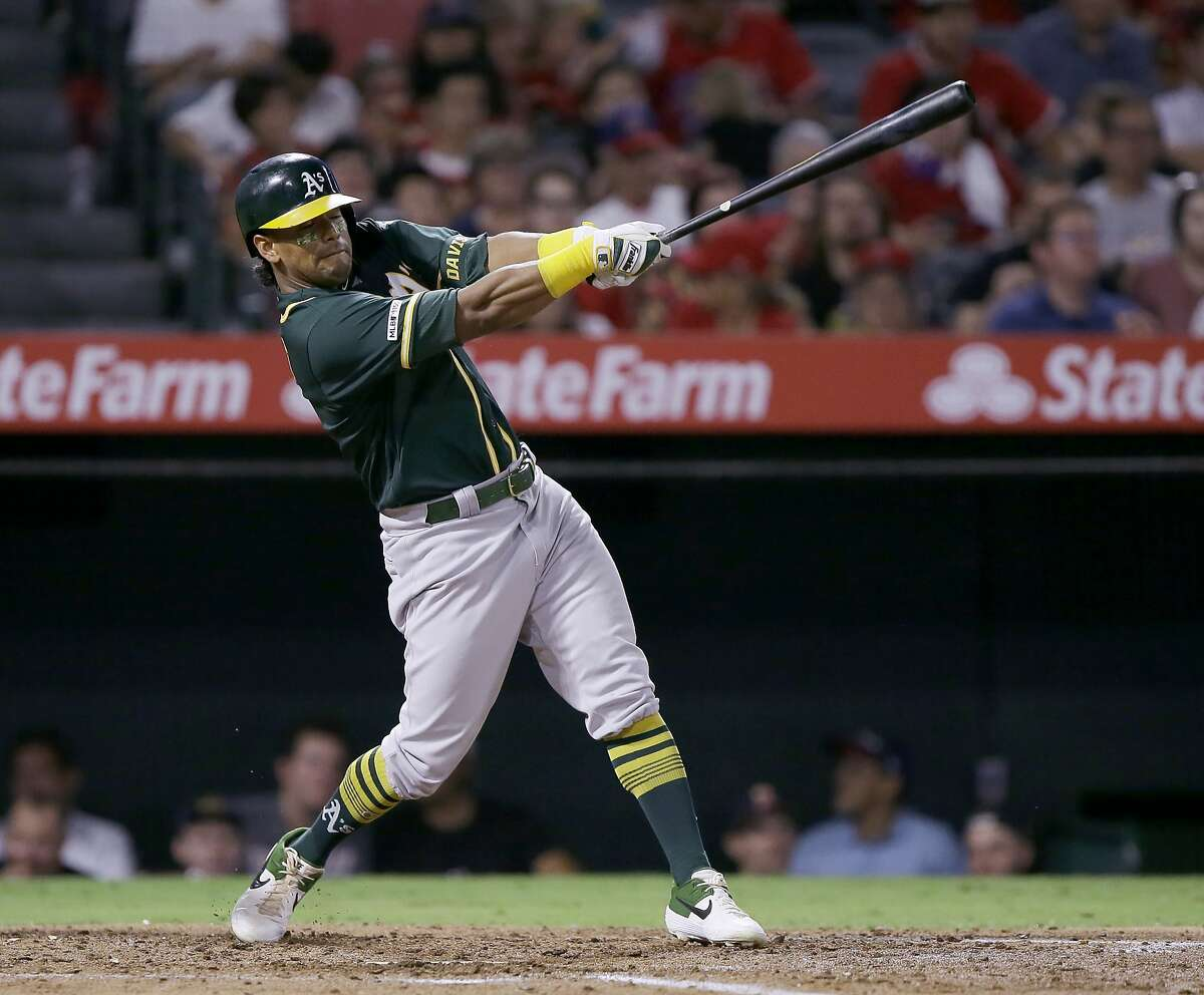 Oakland Athletics designated hitter Khris Davis hits a two-run home run against the Los Angeles Angels during the fourth inning of a baseball game in Anaheim, Calif., Tuesday, Sept. 24, 2019. (AP Photo/Alex Gallardo)