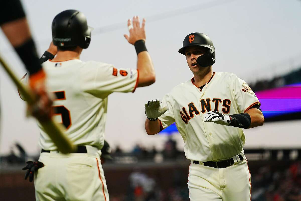 SAN FRANCISCO, CALIFORNIA - SEPTEMBER 24: Buster Posey #28 celebrates a two run home run with Mike Yastrzemski #5 of the San Francisco Giants during the first inning against the Colorado Rockies at Oracle Park on September 24, 2019 in San Francisco, California. (Photo by Daniel Shirey/Getty Images)