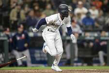 SEATTLE, WA - SEPTEMBER 24: Dee Gordon #9 of the Seattle Mariners hits a double off of starting pitcher Gerrit Cole #45 of the Houston Astros during the third inning of a game at T-Mobile Park on September 24, 2019 in Seattle, Washington. (Photo by Stephen Brashear/Getty Images)