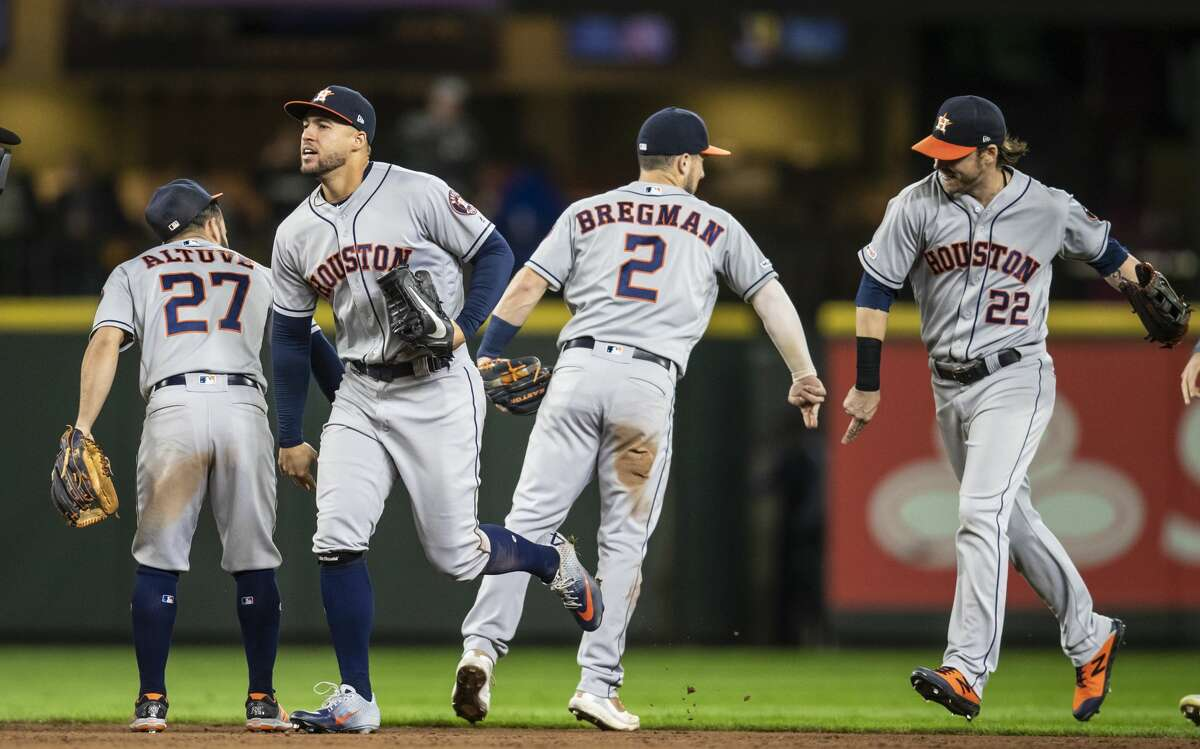 SEATTLE, WA - SEPTEMBER 24: (L-R) Jose Altuve #27 of the Houston Astros, George Springer #4, Alex Bregman #2 and Josh Reddick #22 celebrate after a game against the Seattle Mariners at T-Mobile Park on September 24, 2019 in Seattle, Washington. The Astros won 3-0. (Photo by Stephen Brashear/Getty Images)