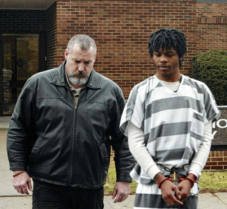Avery Berry is led to court for his first appearance in December 2014. Berry, who was convicted of first-degree murder in the 2014 shooting death of Marcus Jackson, maintains he had ineffective counsel. An appellate court has ordered Berry's case be sent back to Morgan County for an inquiry into his claim. Photo: David C.L. Bauer | Journal-Courier