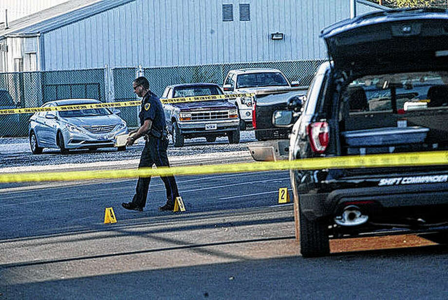 A Jacksonville police officer investigates the scene of a deadly September 2015 shooting in the parking lot of the Municipal Building. Robert Gill pleaded guilty to first-degree murder in the death of his estranged son-in-law, Andrew Maul. Gill's wife and daughter argued his plea prevented them from being charged in a crime that was uncovered during the shooting investigation. The court on Tuesday rejected the argument. Photo: David C.L. Bauer | Journal-Courier