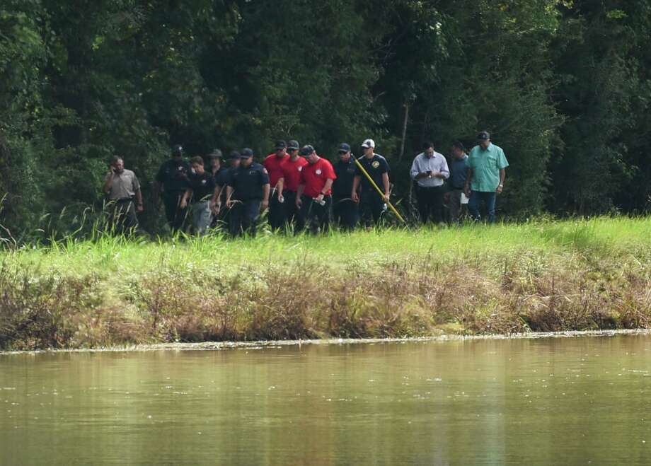 Emergency personnel respond to a body found in the canal off of Moore Road in West Jefferson County Tuesday. Photo taken on Tuesday, 09/24/19. Ryan Welch/The Enterprise Photo: Ryan Welch, Beaumont Enterprise / The Enterprise / © 2019 Beaumont Enterprise