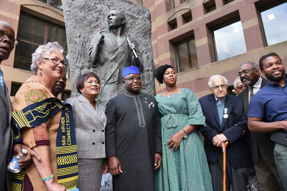 From left, Althea Norcott, New Haven Mayor Toni Harp, Sierra Leone President H.E. Julius Maada Bio and first lady H.E. Fatima Maada Bio, Al Marder and others stand in front of the Amistad Memorial featuring Joseph Cinque at New Haven City Hall on Tuesday. Photo: Arnold Gold / Hearst Connecticut Media / New Haven Register