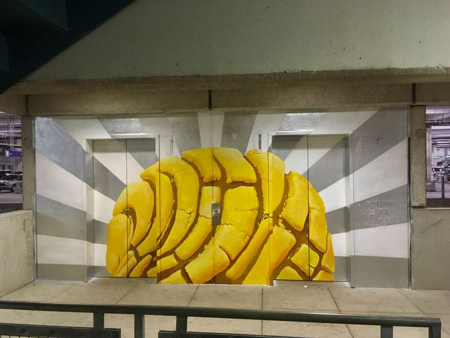 "Local artist Eva Marengo Sanchez, 29, painted ""The Rise of the Concha"" on a set of elevator shaft doors located on Level 2 of the parking garage at the San Antonio International Airport.  Photo: Courtesy Eva Marengo Sanchez"