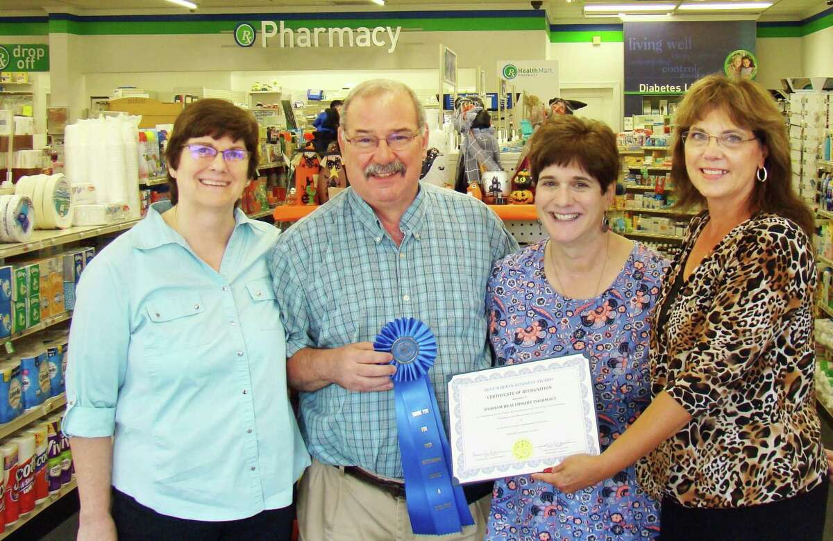 Pictured from left are Carol and Walter Douglass, owners of the Durham Healthmart Pharmacy; Economic Development Commission Chairwoman Janet Morganti and First Selectman Laura Francis.