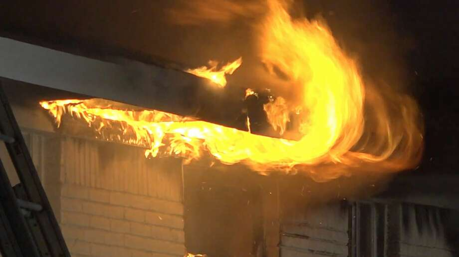 """Houston firefighters tackle an apartment fire with """"suspicious causes"""" in the 6700 block of Ralston on Wednesday, Sept. 25, 2019. Photo: OnScene.TV"""