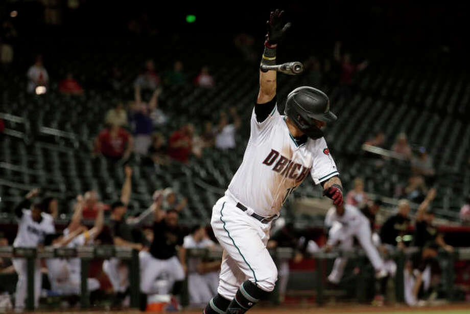 The Diamondbacks' Ildemaro Vargas celebrates his walk off base hit against the Cardinals as teammates run out of the dugout in the 19th inning early Wednesday morning in Phoenix. Photo: Associated Press