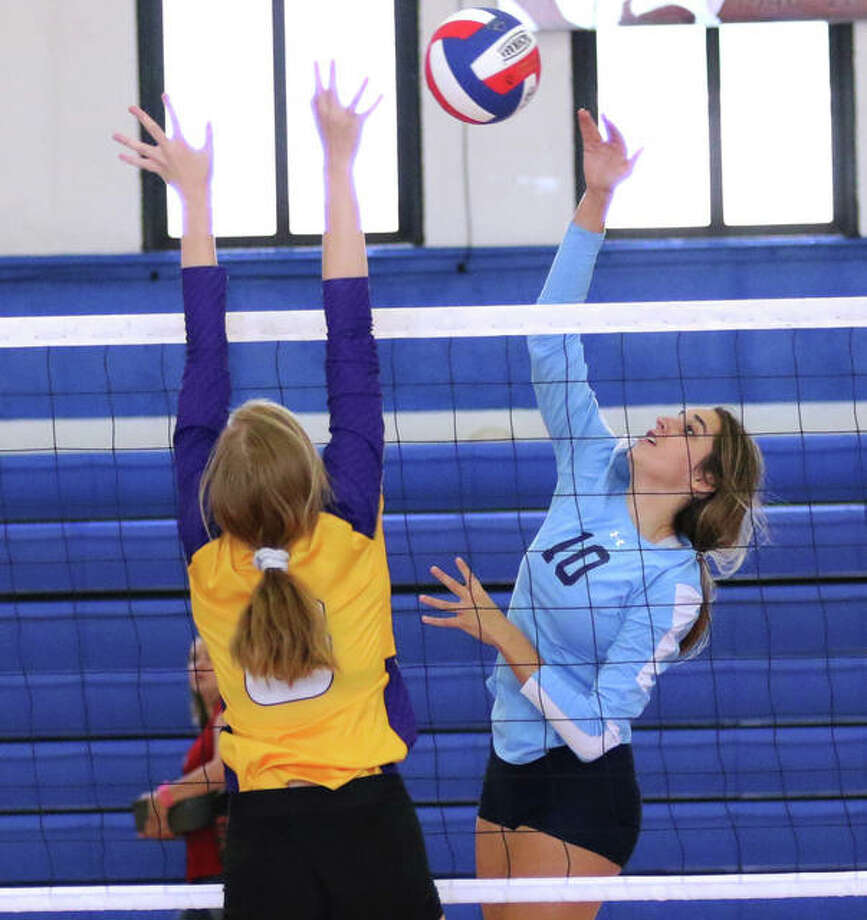 Jersey's Abby Manns (right) hits past the block of CM's Sydney Henke in a match Aug. 31 at the Roxana Tourney. Manns had a career-high 17 kills Tuesday night to lead the Panthers a MVC victory at Highland. Photo: Greg Shashack / The Telegraph