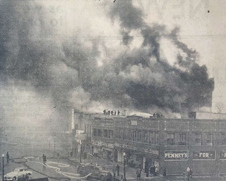 Firemen from adjoining buildings strategically sprayed the burning Frolic Theater building that was destroyed by fire in April 1943, causing damaging estimated at $200,000. All hopes of saving the William A. Cassidy theater were lost when flames spread to the roof, sending it crashing upon the empty but blazing theater seats. April 1943. Photo: Daily News File Photo