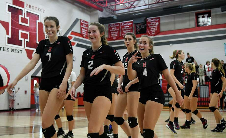 Huffman-Hargrave volleyballers Kylie Willis (7), Saylor Boss (2), and Tina Alley (4) are all smiles after the Falcons striaght-set win over Livingston at Huffman-Hargrave High School on Sept. 28, 2018. Photo: Jerry Baker, Houston Chronicle / Contributor / Houston Chronicle