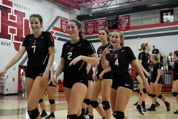 Huffman-Hargrave volleyballers Kylie Willis (7), Saylor Boss (2), and Tina Alley (4) are all smiles after the Falcons striaght-set win over Livingston at Huffman-Hargrave High School on Sept. 28, 2018.