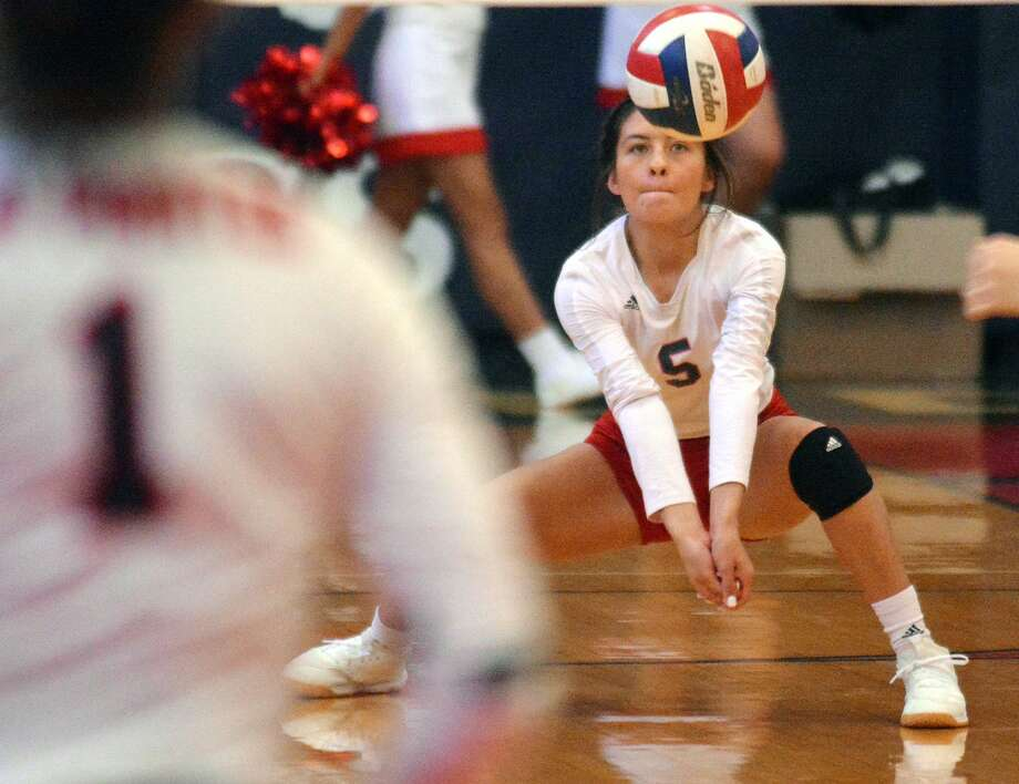 Plainview's Aaliyah Rogers digs the ball off a serve from Lubbock-Cooper during a District 3-5A volleyball match on Tuesday in the Dog House. Photo: Nathan Giese/Planview Herald