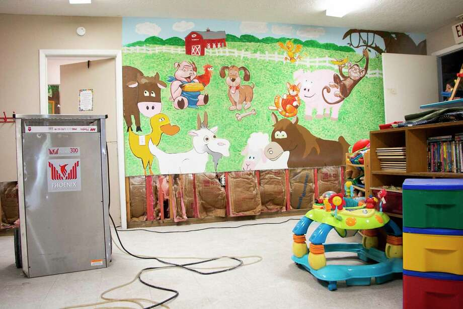 Family Time, the Humble area crisis and counseling center for domestic violence victims, had about three inches of flooding in their shelter on Thursday from Tropical Storm Imelda. A portion of the mural in the children's playroom had to be cut out due to water damage. Photo: By Savannah Mehrtens