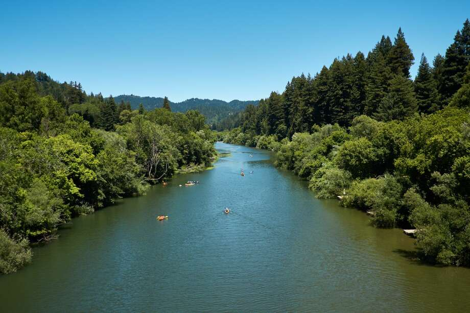 Kayakers paddle up and down the Russian River on a California summer day. Photo: Brad Wenner/Getty Images