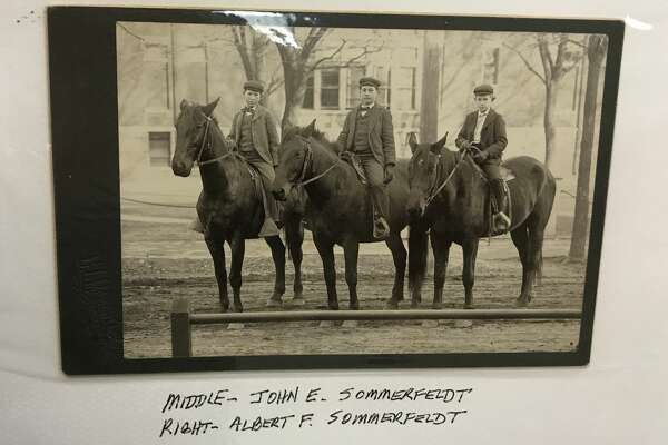 A vintage photograph shows two Sommerfeldt boys on horseback.