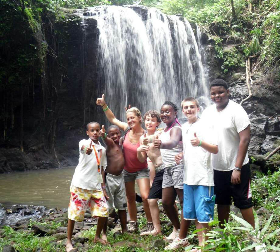 Erique McCalla (grade 6- from Stratford), Miles Green (grade 6 from Bridgeport), Amy Warren (6th grade teacher from Stratford), Malcolm Rowe (7th grade from Fairfield), Kiara Bailey( 7th grade from Stratford), Zachary Patrick (8th grade from Bridgeport), Milton Green III (8th grade from Bridgeport) pose near a waterfall after a rainforest hike in Costa Rica, part of an eight-day trip by students from the Bridgeport interdistrict Six to Six Magnet School. Photo: Contributed Photo / Connecticut Post Contributed