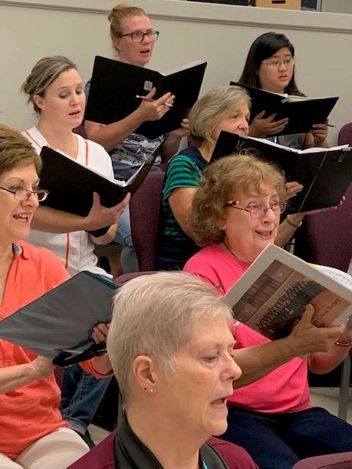 Members of the Montgomery County Choral Society rehearse for the group's first concert set for Thursday, Oct. 3