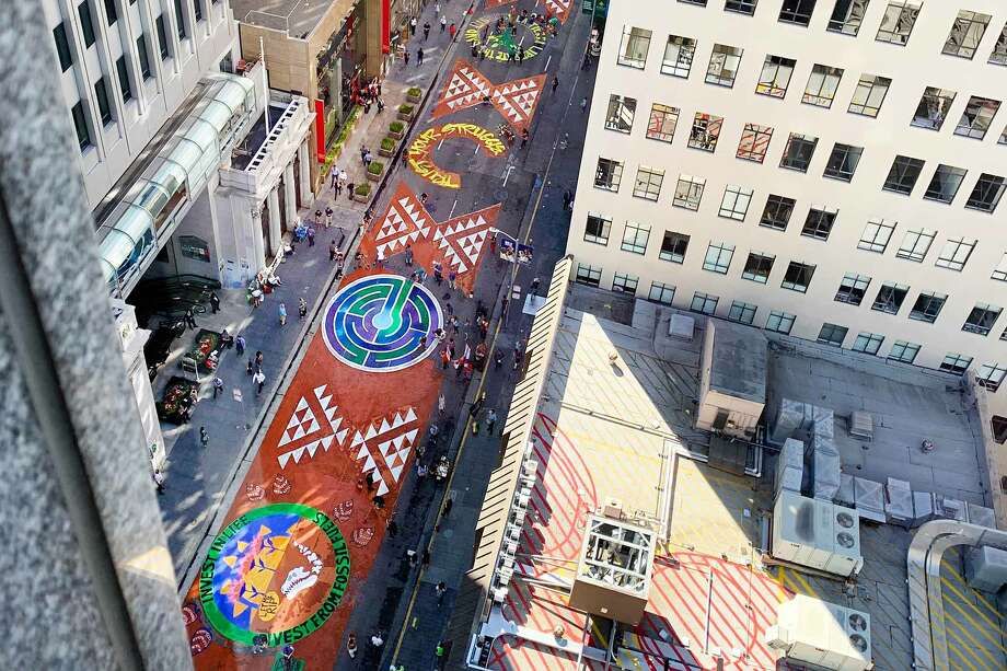 """Climate activists with the """"Strike for Climate Justice"""" protest painted a two-block-long stretch of Montgomery Street in San Francisco with a mural on Sept. 25, 2019 Photo: Mary Spadaro"""