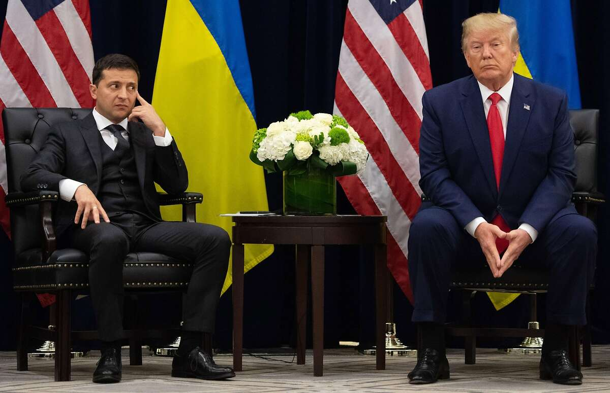 US President Donald Trump and Ukrainian President Volodymyr Zelensky looks on during a meeting in New York on September 25, 2019, on the sidelines of the United Nations General Assembly. (Photo by SAUL LOEB / AFP) (Photo credit should read SAUL LOEB/AFP/Getty Images) *** BESTPIX ***