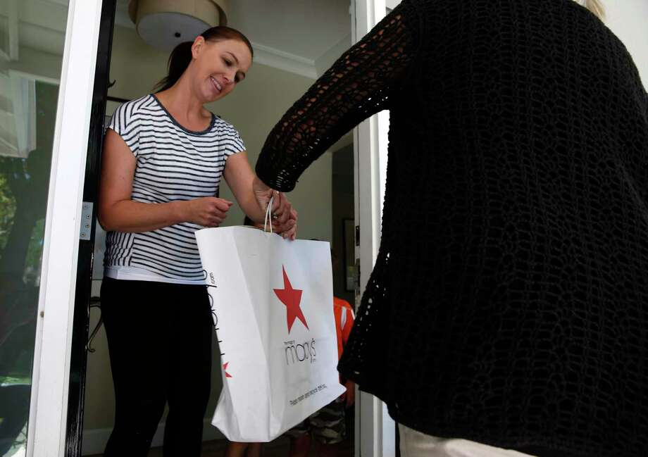 Jennifer Tayebi accepts a delivery of merchandise from deliv.co driver Lynne Richardson in Menlo Park, Calif. on Friday, June 21, 2019. Photo: Paul Chinn, Staff / The Chronicle / ONLINE_YES