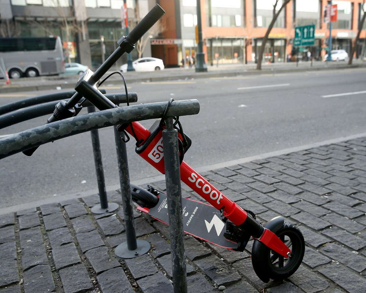 A Scoot e-scooter is parked on King Street in San Francisco, Calif. on Tuesday, March 19, 2019.