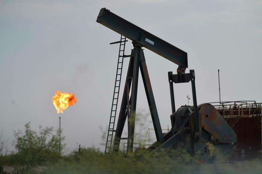 Oil-industry equipment and flares are common sights in the landscape around Mentone, the sparsely populated town in Loving County in West Texas that is experiencing an oil boom. Photo: Billy Calzada, Staff / Staff Photographer / San Antonio Express-News
