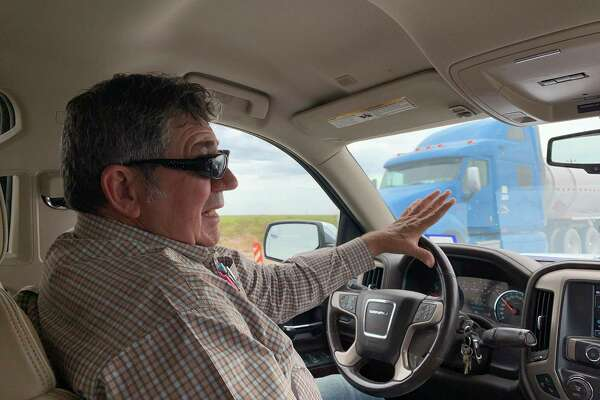 Loving County Judge Skeet Lee Jones drives to lunch by truck traffic in Mentone, Texas, the sparsely populated town in Loving County in West Texas that is experiencing an oil boom.