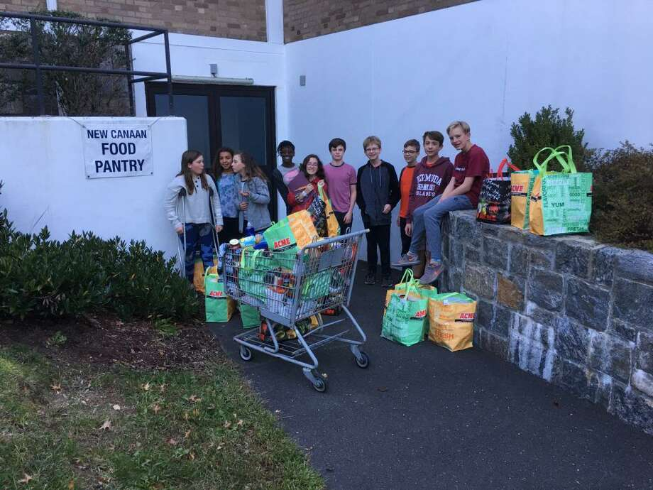 Students in the First Presbyterian Church of New Canaan Confirmation class deliver food to New Canaan Food Pantry where supplies are needed. Photo: First Presbyterian Church Of New Canaan