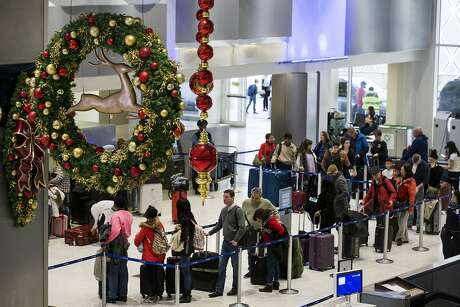 Airline passegers make their way through the ticketing area of Terminal C at George Bush Intercontinental Airport in advance of the Christmas holiday on Friday, Dec. 21, 2018, in Houston. More than 3 million passengers are expected to depart from, arrive to or connect through Bush Intercontinental Airport between Dec. 14 and Jan. 6.