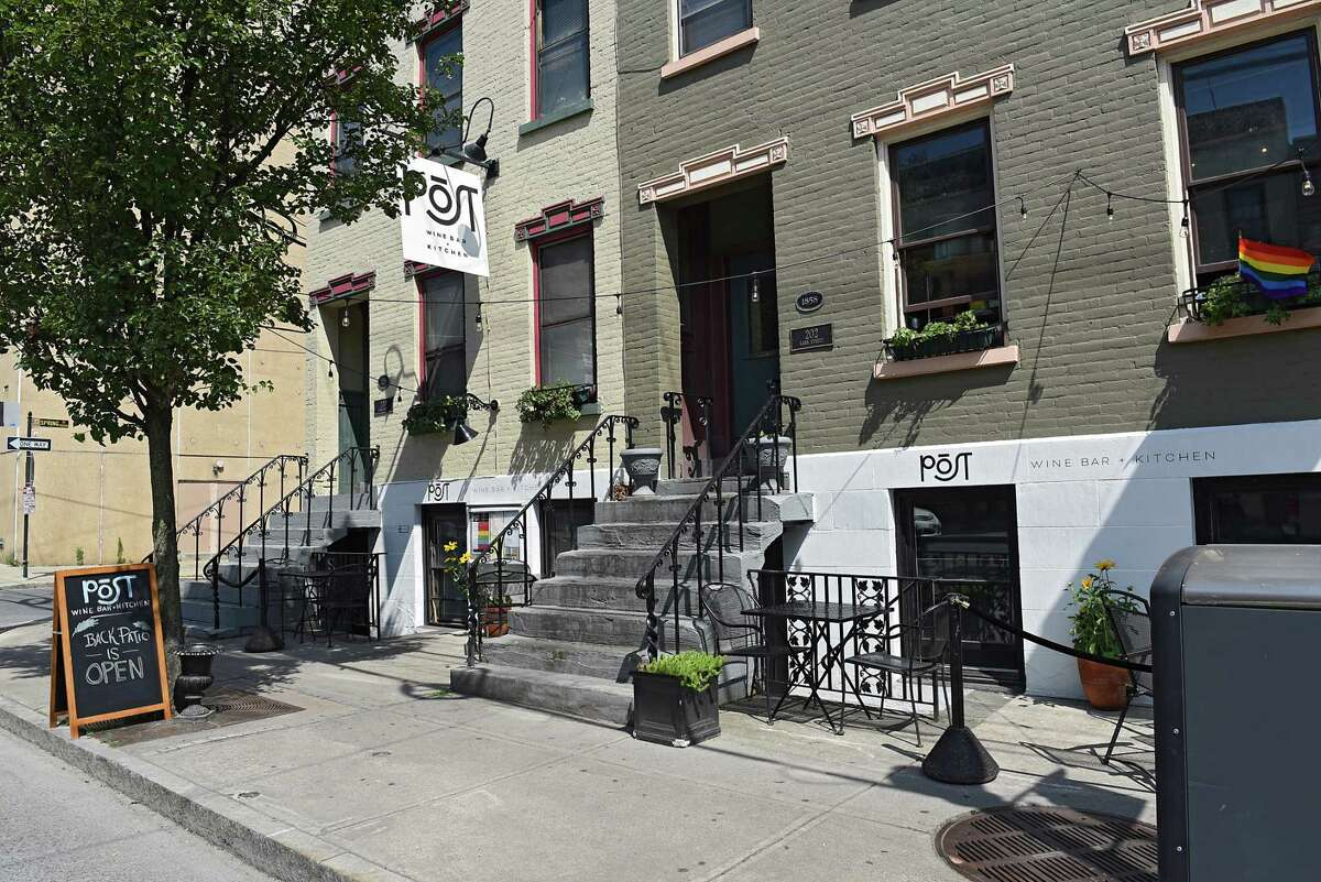 The wine bar Post, on Lark Street in Albany, seen during its first summer, in 2019. It is closed as of October 2021, and the space, in adjoining basements with a rear courtyard that has been multiple wine bars since 2002, will be redeveloped into a new concept by the current owners.