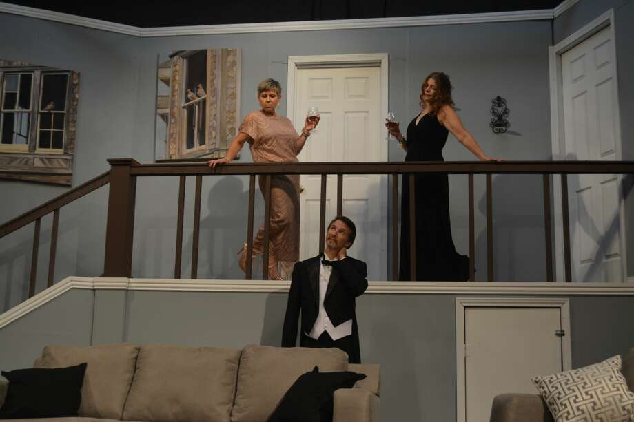 """Two paintings by Dickinson artist Sue Bown line the landing in the set for Bay Area Harbour Playhouse's production of Neil Simon's """"Rumors."""" Performers include Heather Green, left, Christopher Lowe and Ande Smith. Photo: Bay Area Harbour Playhouse"""