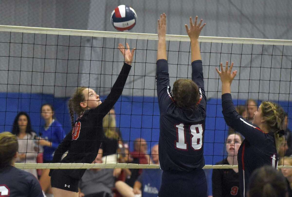 New Canaan's Alex Gillespie (10) puts a shot back at Avon during the CIAC's Early Season Block Party Volleyball Tournament at the CT Sports Center in Woodbridge on Saturday, Sept. 14, 2019.