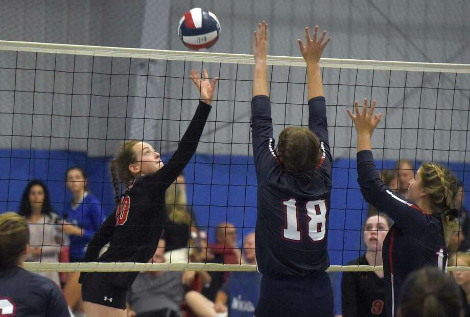 New Canaan's Alex Gillespie (10) puts a shot back at Avon during the CIAC's Early Season Block Party Volleyball Tournament at the CT Sports Center in Woodbridge on Saturday, Sept. 14, 2019. Photo: Dave Stewart / Hearst Connecticut Media / Hearst Connecticut Media
