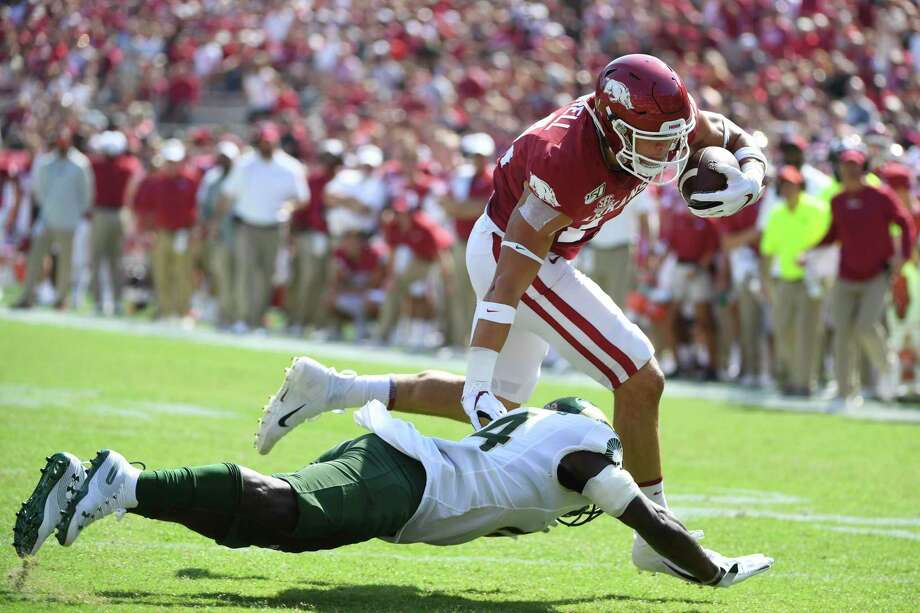 Arkansas tight end Chase Harrell slips past Colorado State defender Anthony Hawkins to score a touchdown earlier this month in Fayetteville, Ark. Photo: Michael Woods, FRE / Associated Press / Copyright 2019 The Associated Press. All rights reserved.