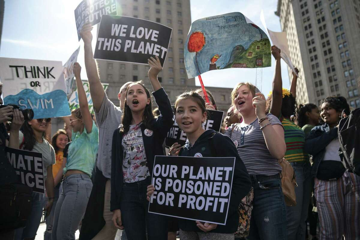 Young activists and their supporters rally for action on climate change earlier this month in New York City. Some Republicans are shifting their views as they see the demographic of climate change supporters is growing and getting younger.
